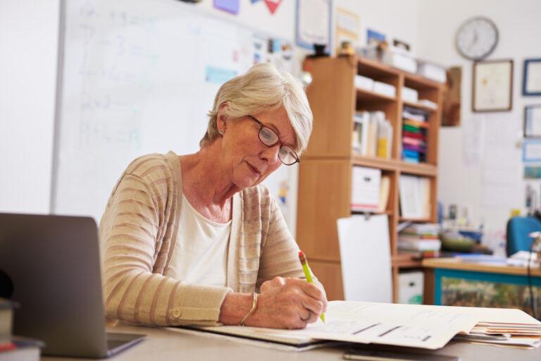Senior female at her desk working